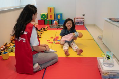 June 20, 2019 -- Abu Dhabi -- Student Ambassador Aya Hammad with a patient. Patient screening takes place in Abu Dhabi ahead of two days of surgeries organized by Operation Smile UAE to repair cleft lips and palates. Image Courtesy Operation Smile UAE