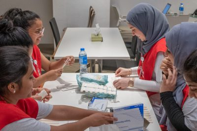 June 21, 2019 - (Abu Dhabi, UAE) - Student Ambassadors making braces to prevent childrern from pulling on their tongue stich. The OS UAE 2019 Mission first day of cleft palate and lip surgeries. Image Courtesy Operation Smile UAE